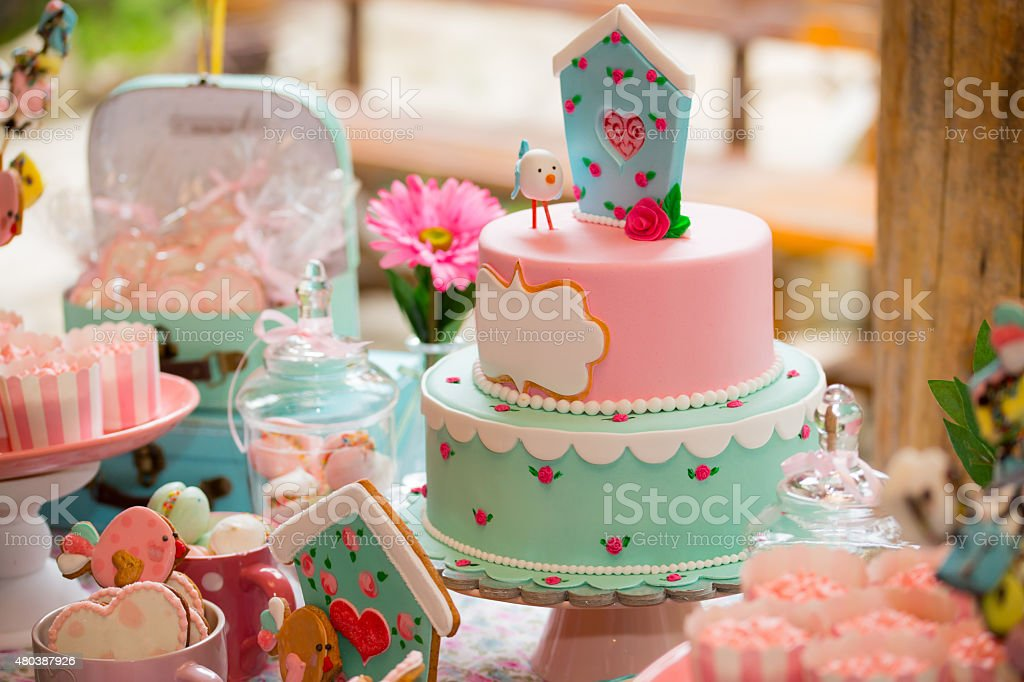 Birthday party table with sweets for kids stock photo