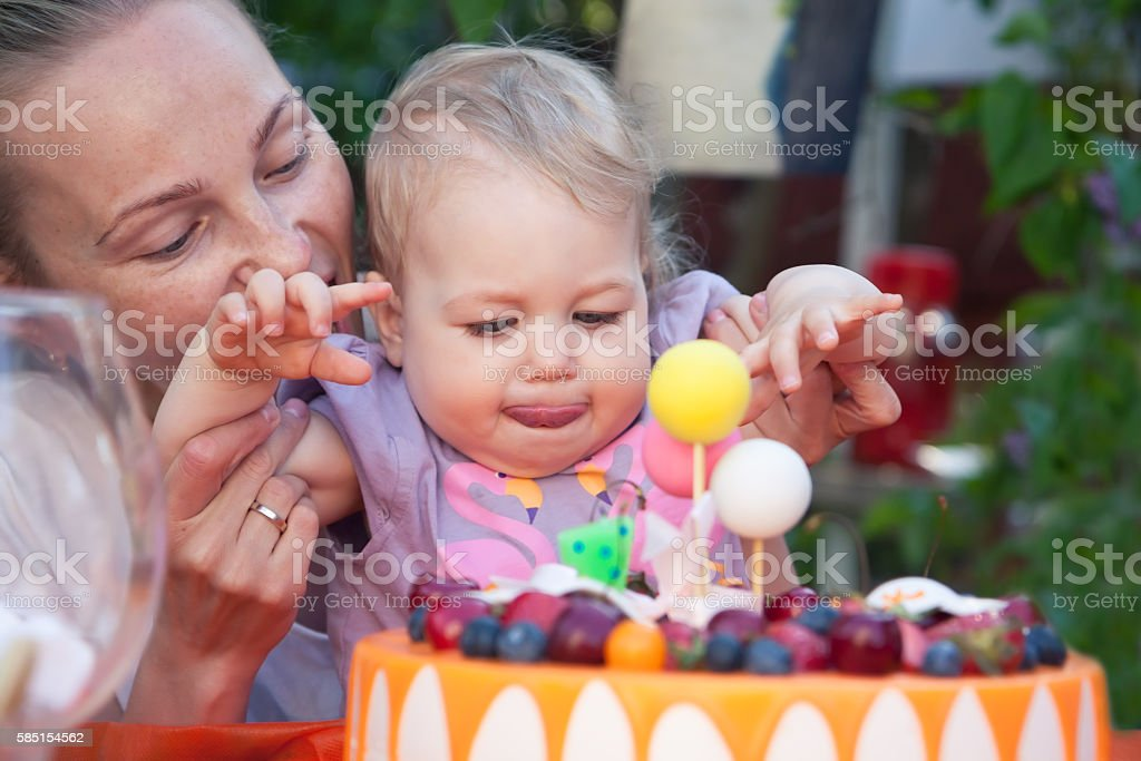 birthday party with the happy faces of baby and mother stock photo