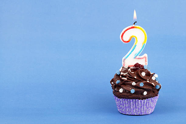 Birthday Cupcake with numbered candle. 2 3 years stock pictures, royalty-free photos & images