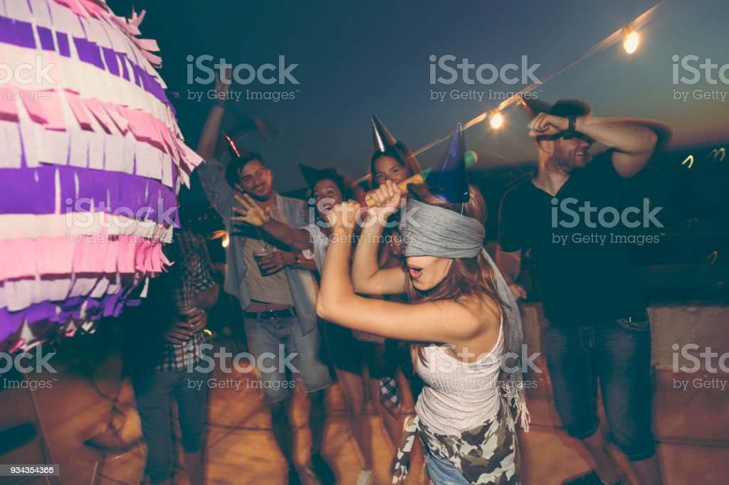 Birthday pinata hitting stock photo