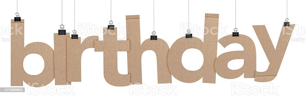 birthday word hanging on strings stock photo