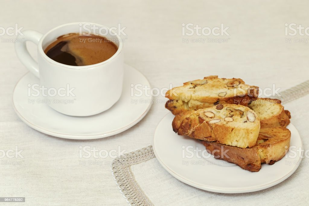 Biscotti cookies and White cup of coffee royalty-free stock photo