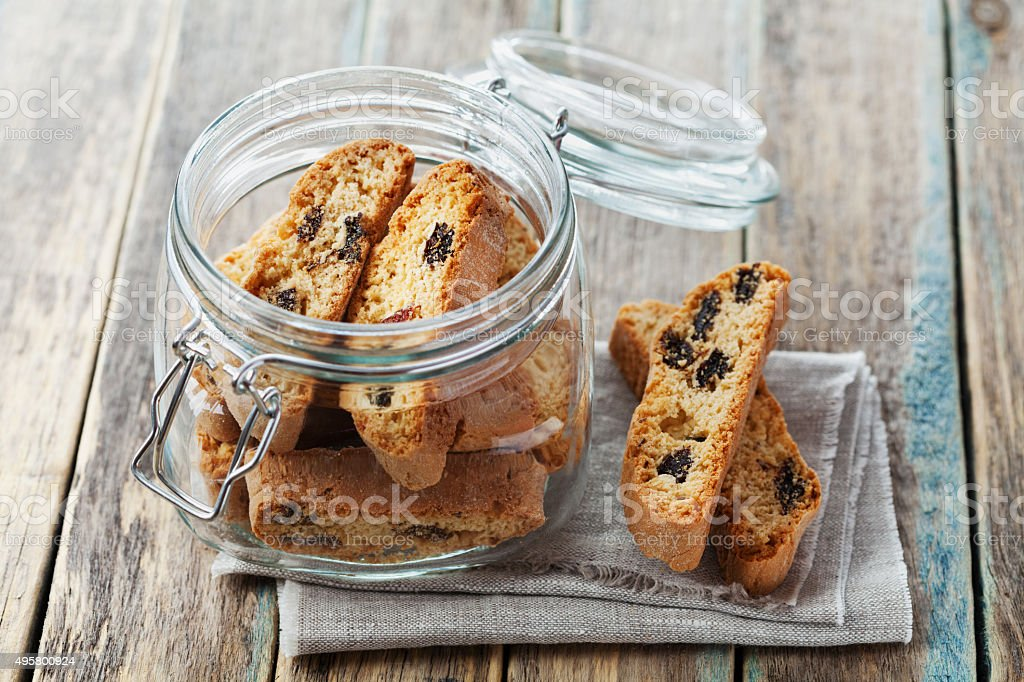 Biscotti or cantucci with raisins in a glass jar stock photo