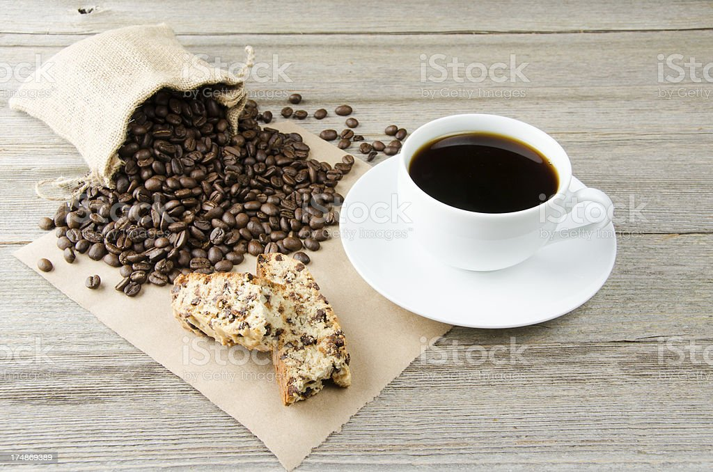 Biscotti with a Cup of Coffee and Beans royalty-free stock photo