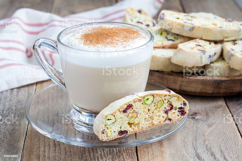 Biscotti with cranberry and pistachio, cup of coffee latte stock photo
