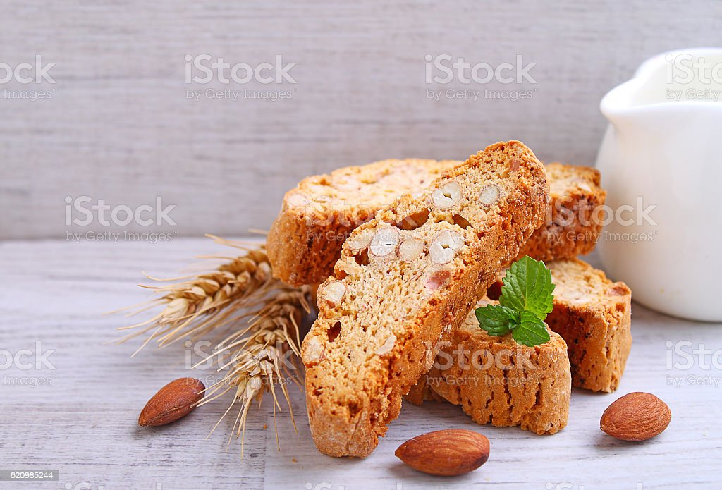 Biscotti with nuts on a wooden background stock photo