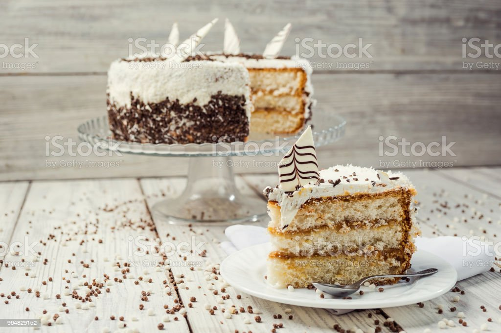 biscuit cake with caramel and chocolate on a wooden background royalty-free stock photo
