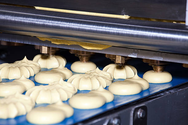 biscuit depositing machine - depositor stock pictures, royalty-free photos & images