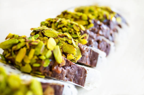 biscuit mosaic chocolate with pistachio crumbs close up stock photo