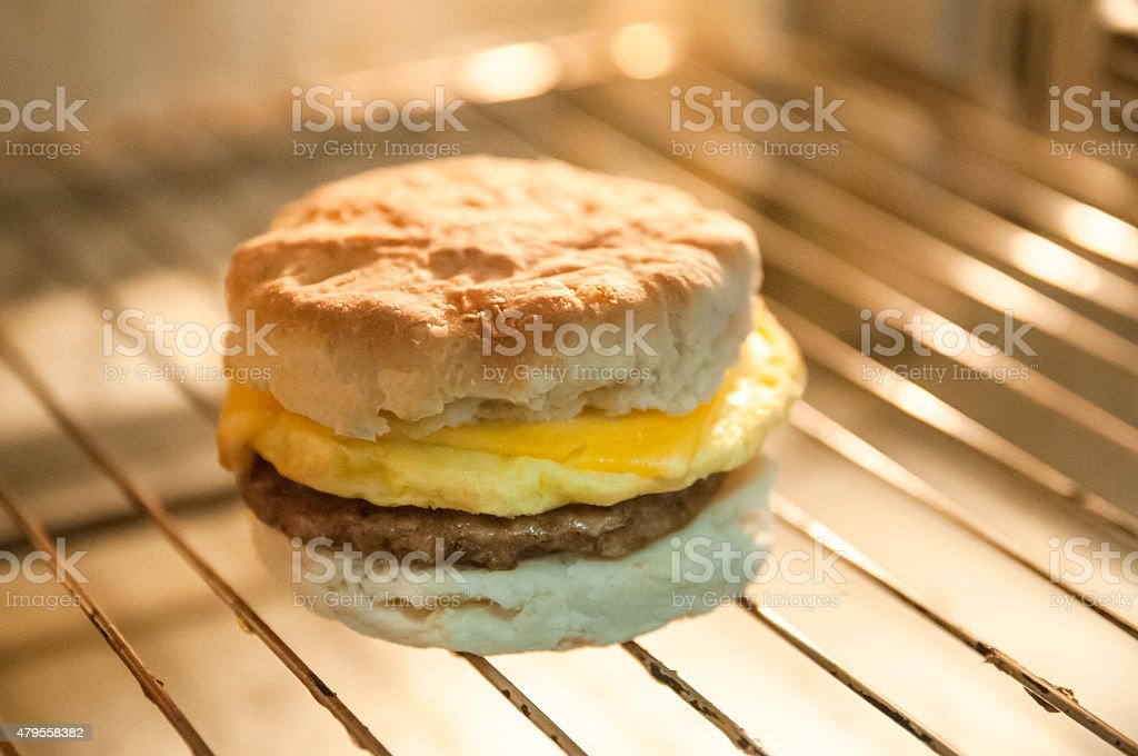 Biscuit, Sausage, egg & cheese. Breakfast sandwich cooking stock photo