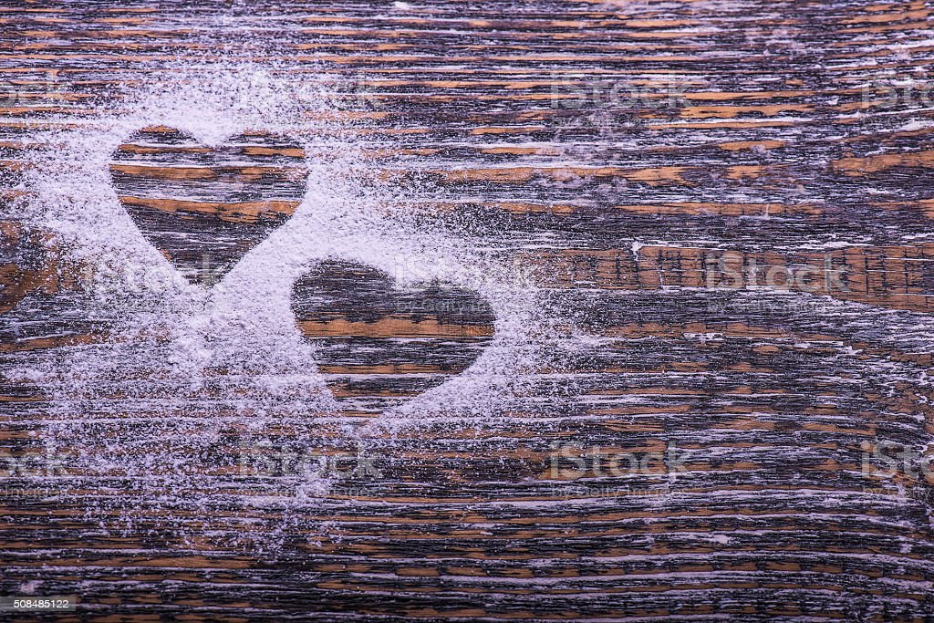 Biscuits and cookies in shape of heart, wooden board stock photo