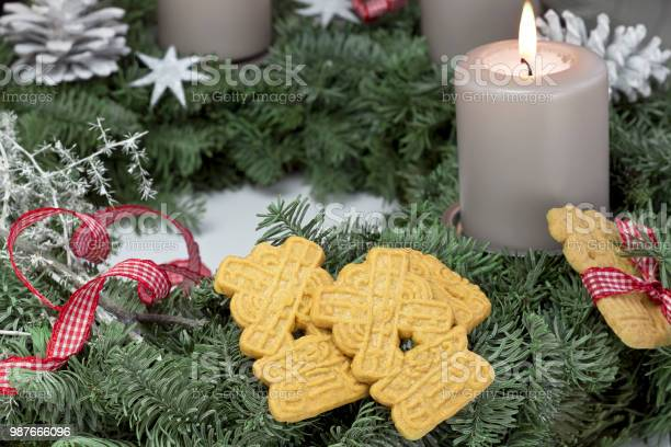 biscuits in christmas decoration with burning candle