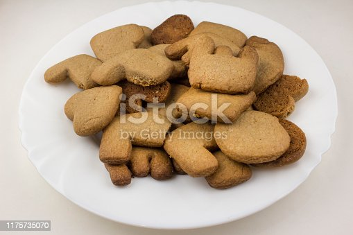 Biscuits love on a white plate and against a white background