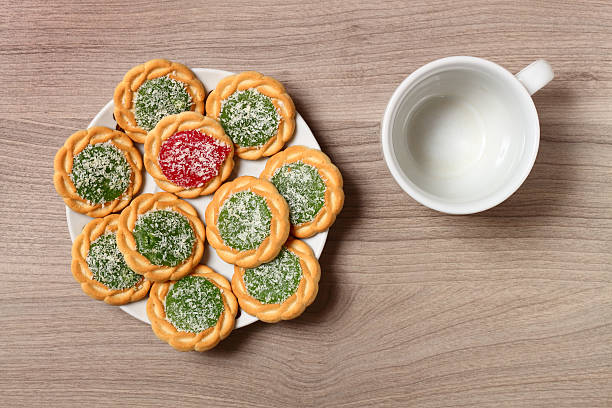 Biscuits on a plate and empty coffee cup. stock photo