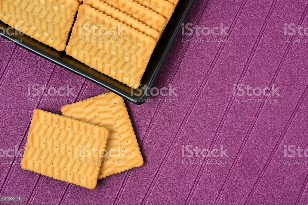 Biscuits plateau purple background stock photo