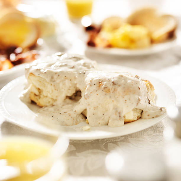 biscuits with sausage gravy biscuits with sausage gravy shot close up at breakfast biscuit stock pictures, royalty-free photos & images