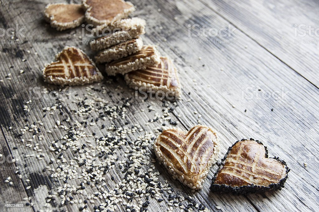 Biscuits with sesame seeds were scattered on the table royalty-free stock photo