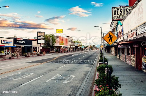 Bishop, California, United States - October 17, 2015: Main Street on Bishop town in Owens Valley, California on a quiet autumn morning. With a population of under 4000, it lies on Highway 395, which runs through the centre of town, and is world famous as a venue for rock climbers who specialise in short difficult boulder climbs. Its many shops service a wide geographic area.