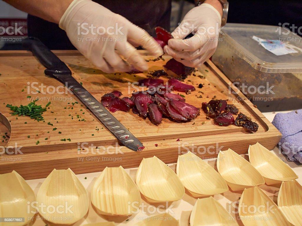 Bison Tenderloin cut by a chef stock photo