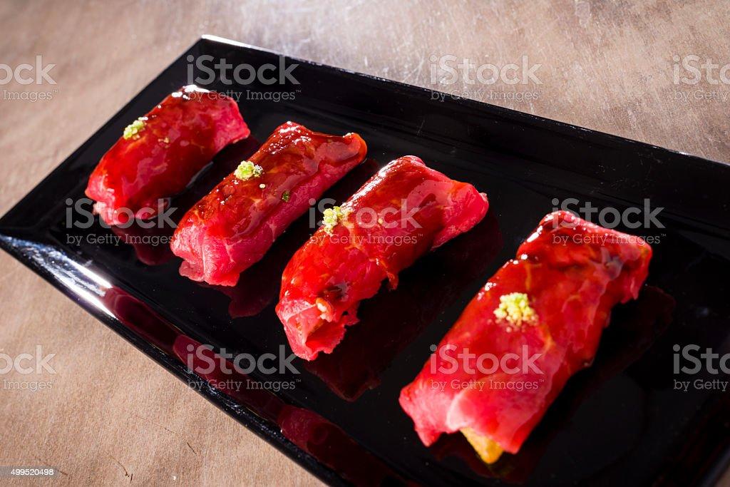 Bisonte fillet, airbag niguiri, bone marrow mouse stock photo