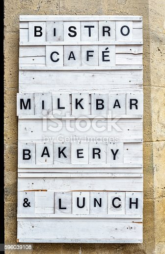 istock Bistro wooden panel on a stone wall. 596039108