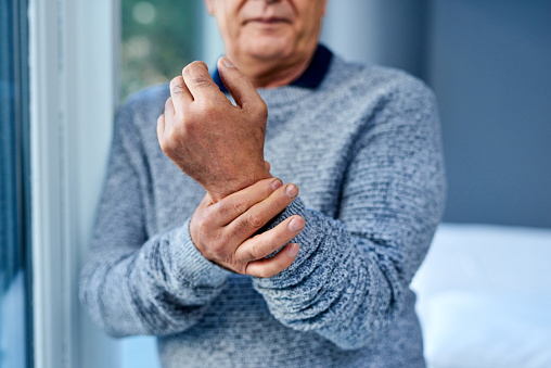 Shot of an unrecognisable senior man suffering from wrist pain