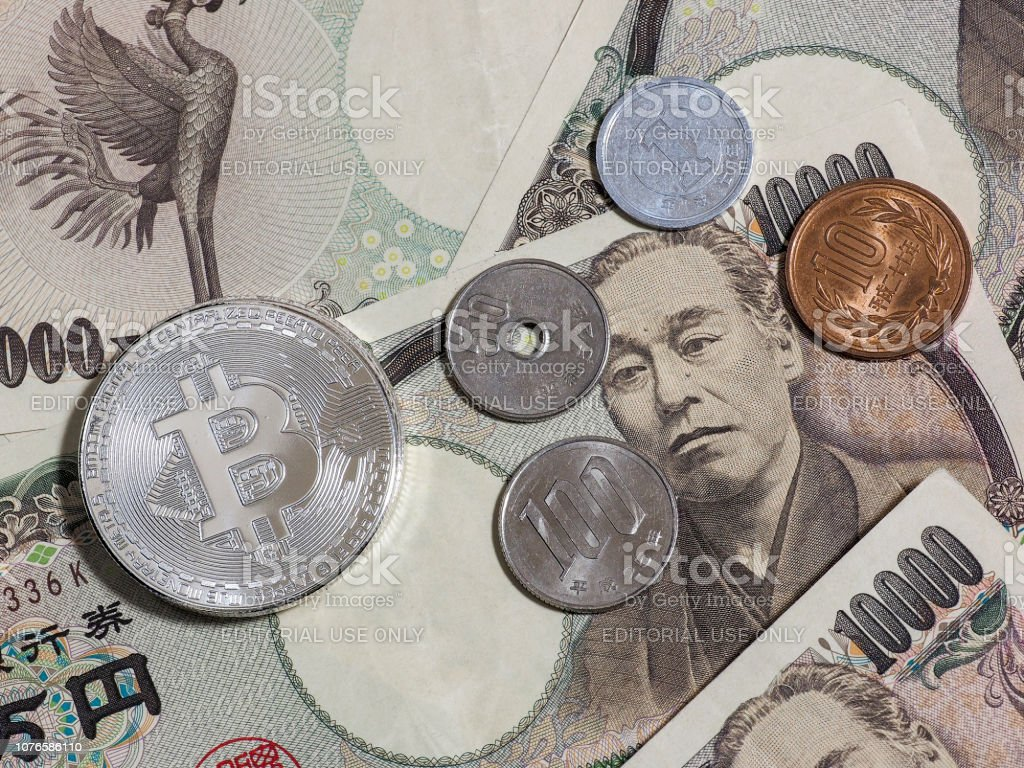 Bitcoin and Japanese coins on Japanese 10,000 yen stock photo