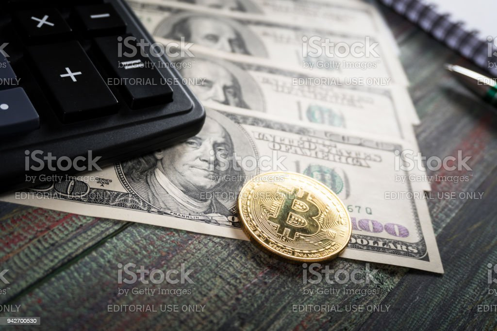 Bitcoin and keyboard calculator in a business office stock photo