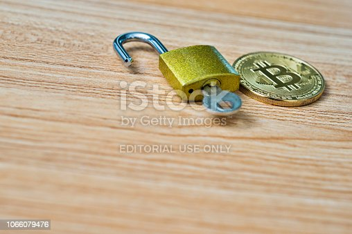 istock Bitcoin and padlock on wooden table 1066079476