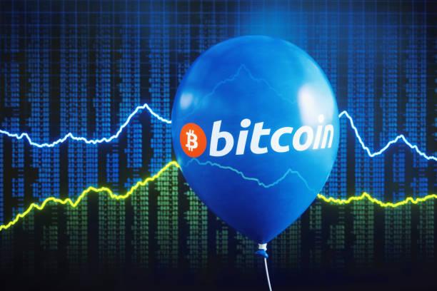 Bitcoin bubble with defocused stock exchange stock photo