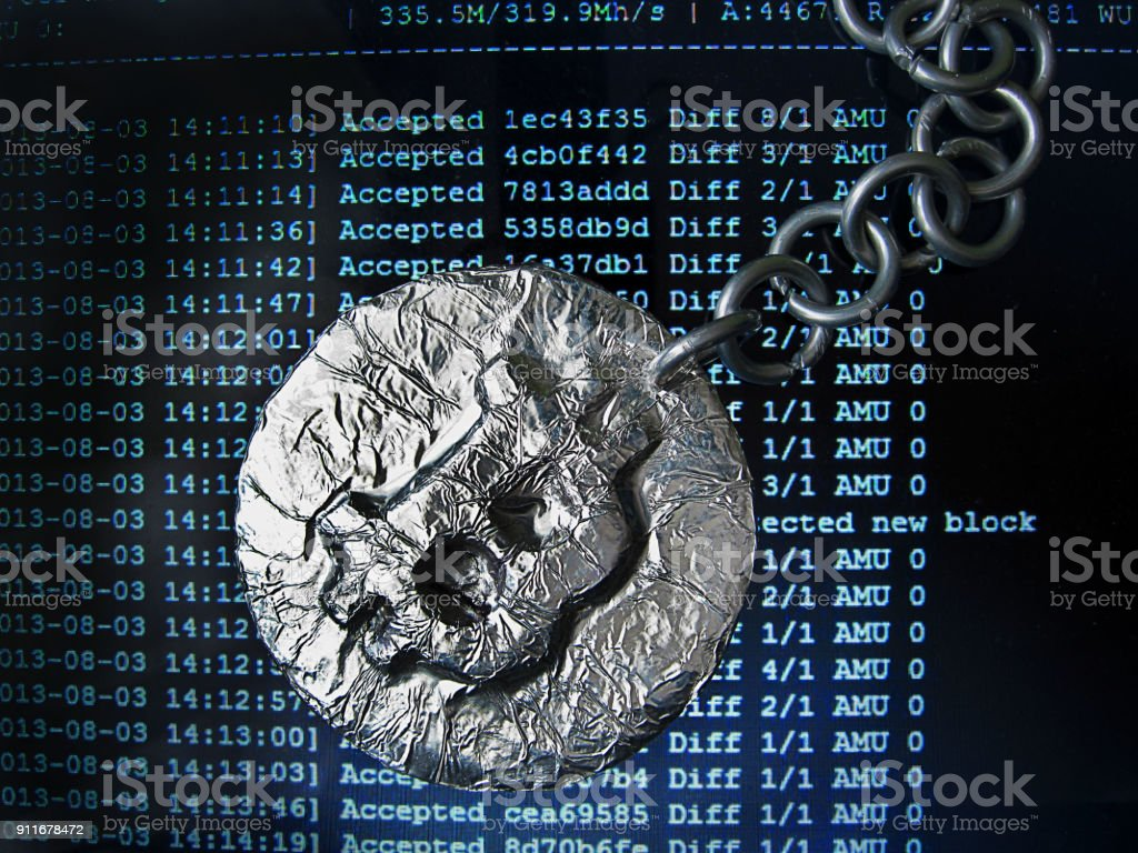 Bitcoin chain. Real coin of crypto currency joined by metal chain is on a mining computer screen stock photo