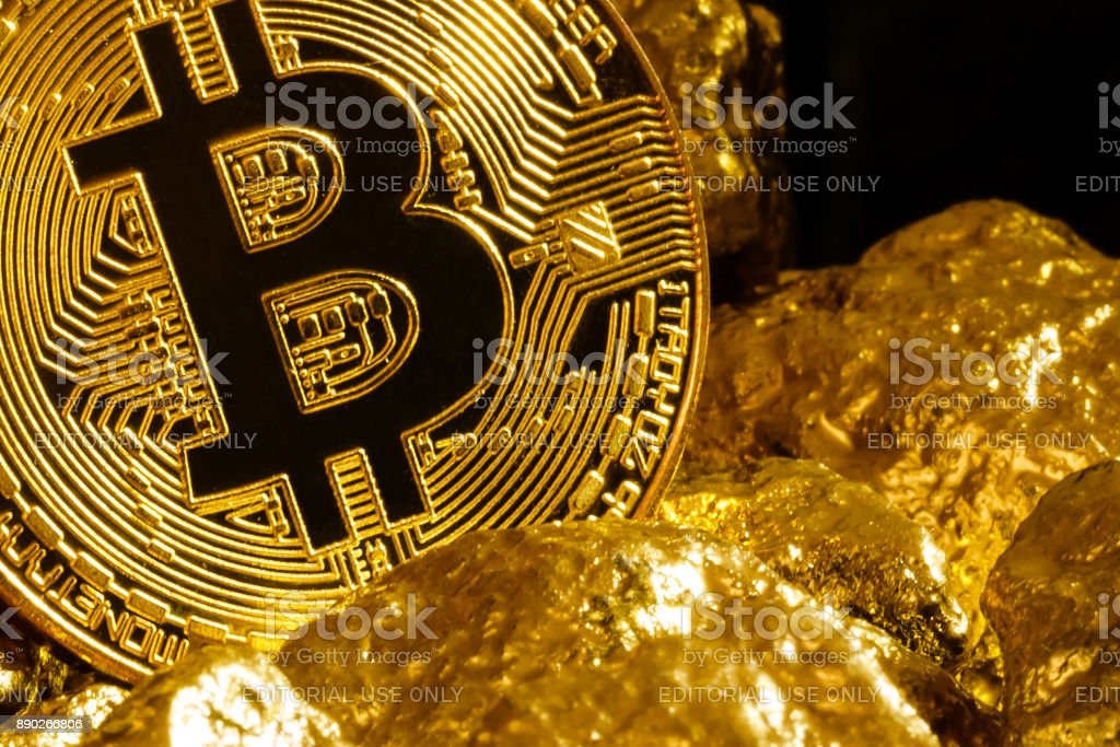 Bitcoin coin and mound of gold nuggets bitcoin cryptocurrency stock photo