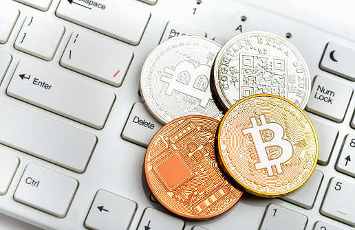 Bitcoin Coin On White Keyboard Stock Photo - Download Image Now