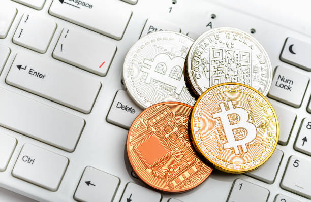Bitcoin coin on white keyboard stock photo