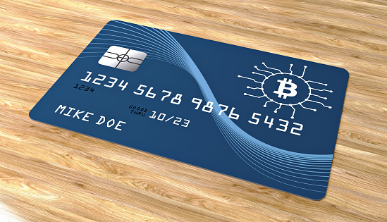bitcoin credit card on wood background stock photo