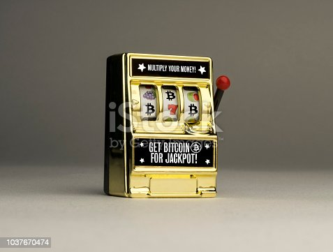 Conceptual casino one armed bandit slot machine to emphasise the reality of gambling risks with cryptocurrency and Bitcoin
