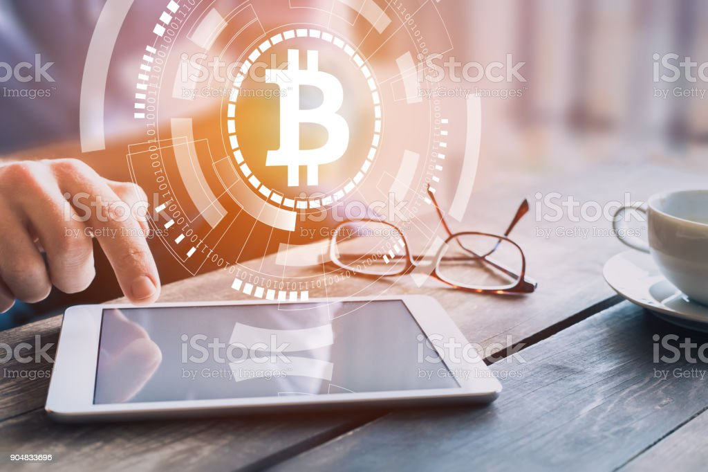 Bitcoin cryptocurrency investing, trading concept, businessman, digital tablet, BTC symbol - fotografia de stock