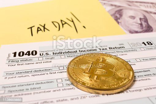 Bitcoin coin with 1040 income tax form for 2018 for filing on April 15. Slovenia, January 12, 2019