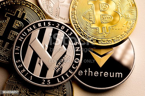 izmir, Turkey - January 12, 2018 Close up shot of three main cryptocurrencies; bitcoin, ethereum and litecoin in dark surface.