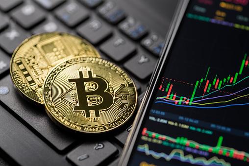 Ljubljana, Slovenia - may 12 Bitcoin gold cryptocurrency trading chart on smartphone close up.