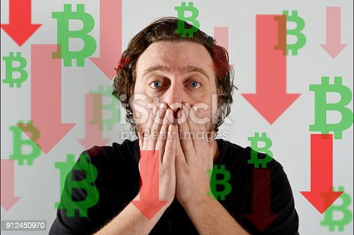 istock Bitcoin is moving down and young man be surprised 912450970