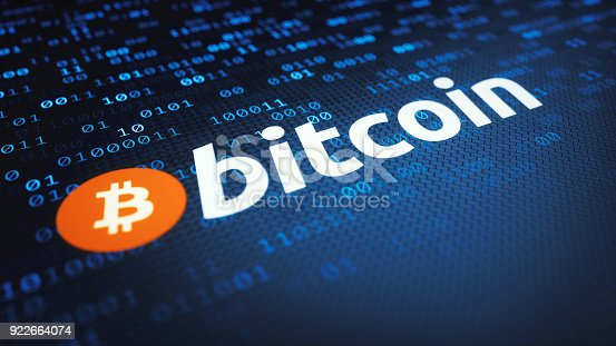 Bitcoin logo and label on a dark surface with encrypted binary data