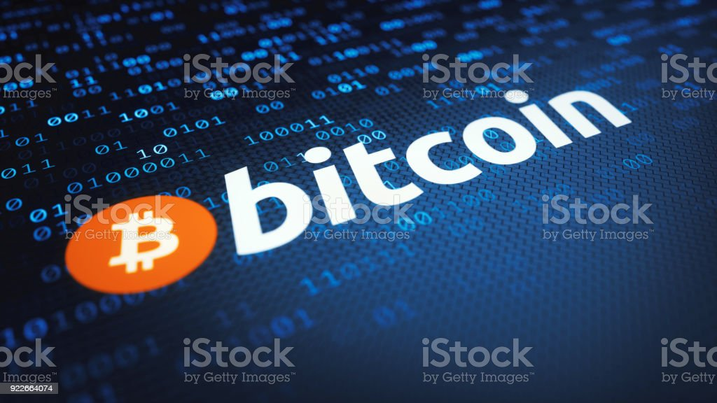 Bitcoin logo and label on a binary surface stock photo
