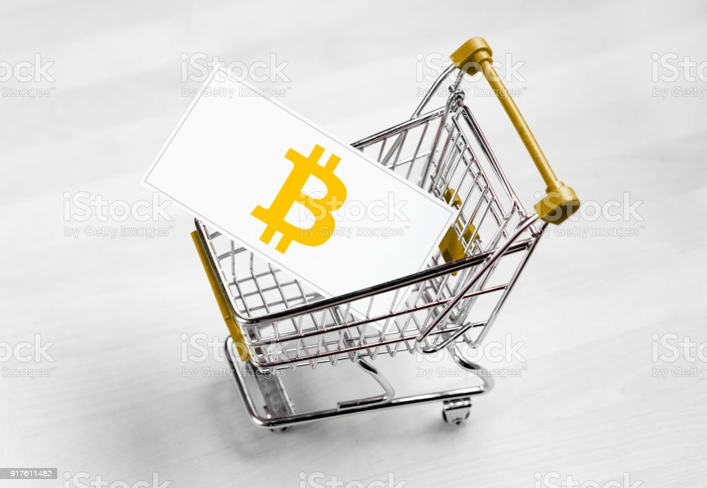 Bitcoin logo on a business card in shopping cart. stock photo