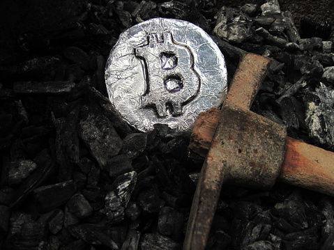 Bitcoin Mining A Mine With Real Hardware Symbols Of Block Chain Technology For Crypto Currency Metal Coin Coal Pickaxe Stock Photo - Download Image Now