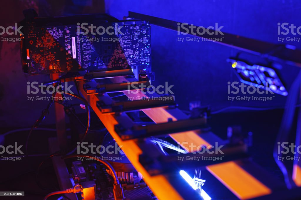 GPU bitcoin mining farm at night stock photo