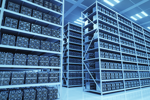 Interior of a cryptocurrency mining farm with ASIC mining rigs.