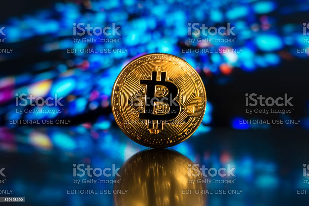 bitcoin on a led technological light surface izmir, Turkey - November 20, 2017  Studio shot of golden Bitcoin with a digital background Banking Stock Photo
