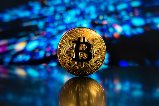 Bitcoin On A Led Technological Light Surface Stock Photo - Download Image Now