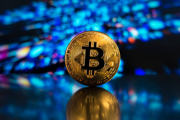 bitcoin on a led technological light surface stock photo